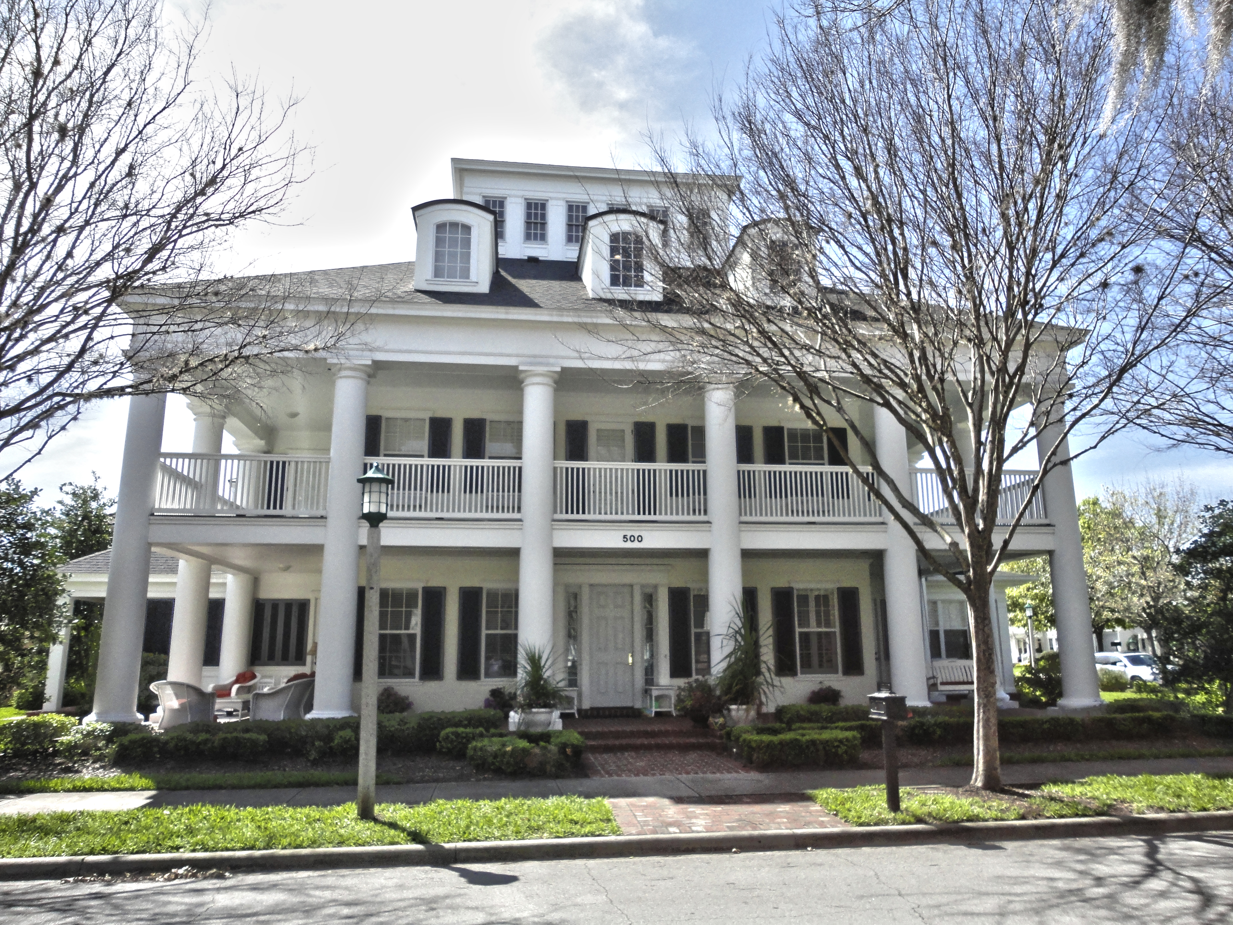Sunday style homes of celebration celebrate decorate for Homes with porches all the way around