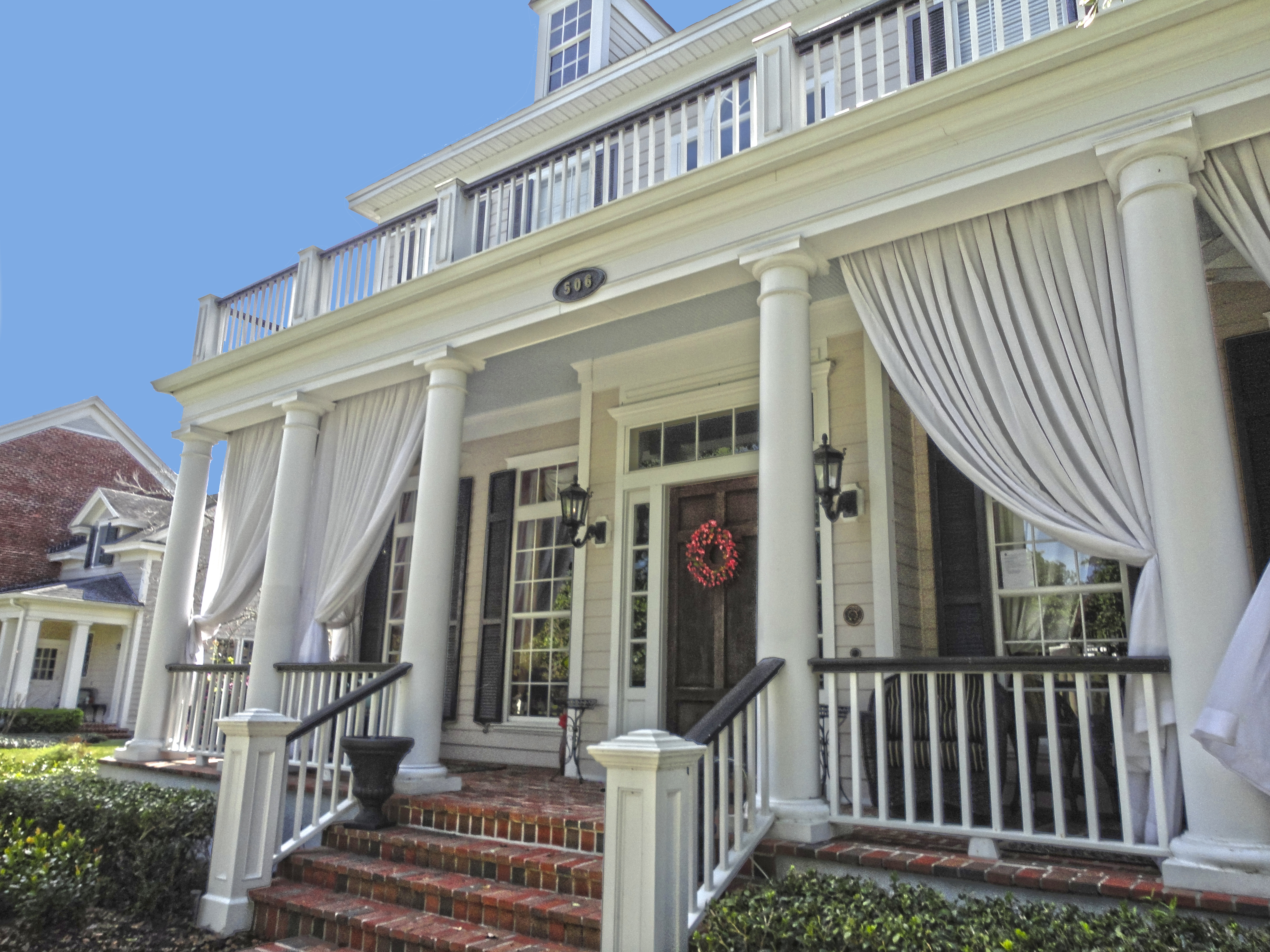 Sunday style homes of celebration celebrate decorate for Side porch