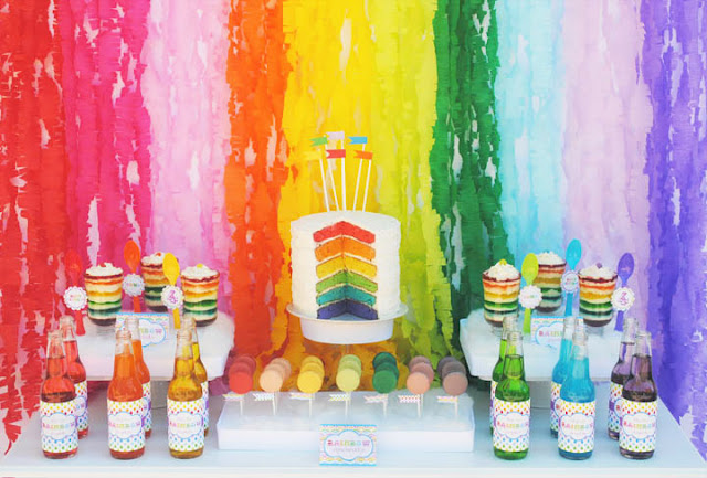 Rainbow backdrop created from crepe paper streamers.