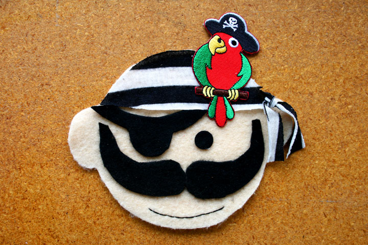 Pirate party invitation made of felt and trimmed with an iron on pirate parrot applique