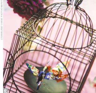 birdcage centerpiece featuring origami birds