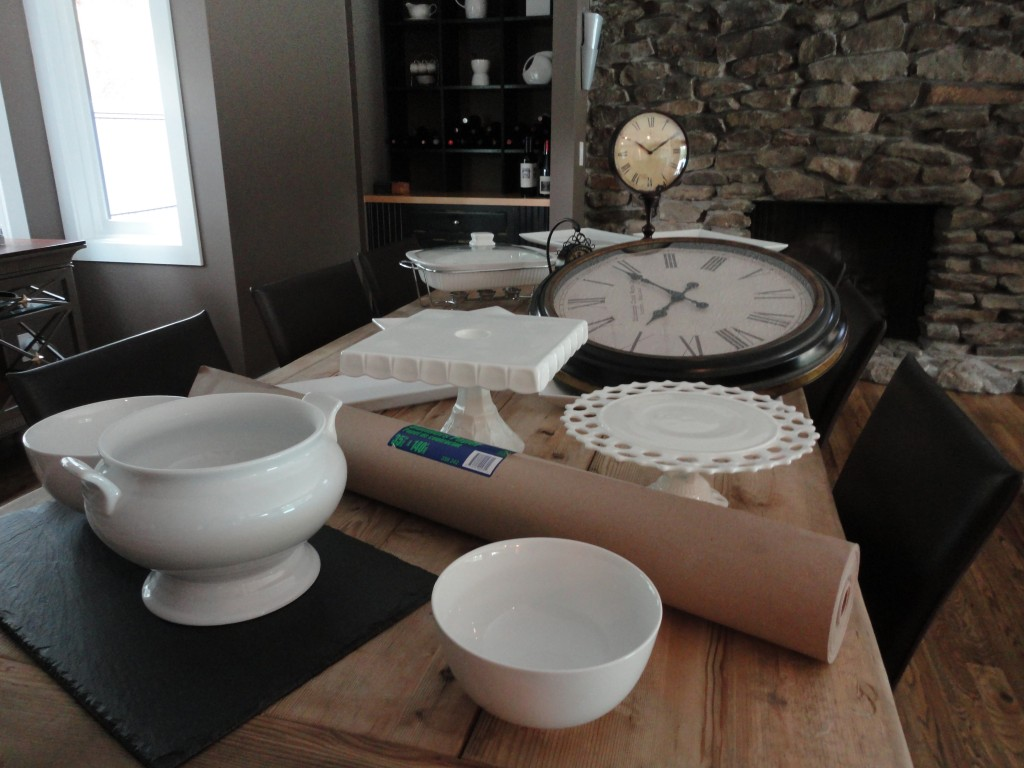 White dishes, rustic table, clocks, slate cheese board, cake plates, pedestal cake plate