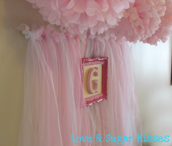 Party backdrop in pink tulle, like a tutu.