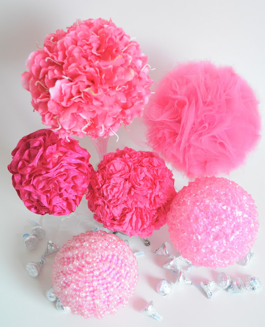 Pink pompons or spheres decorated with different items, beads, paper, fabric, tulle