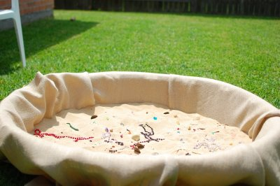 Pirate treasure hunt in the sand at a Pirate themed birthday party
