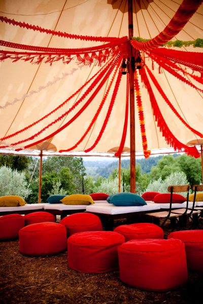 Wedding in a tent, wedding lounge in a tent, red and yellow and orange tent decor