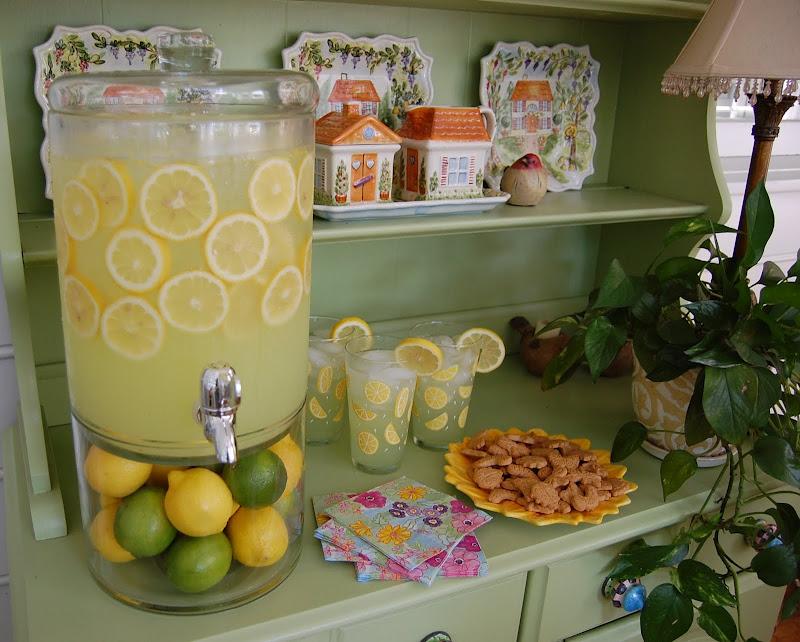 Beverage dispenser for serving lemonade or limeade, with sliced lemons in the lemonade.