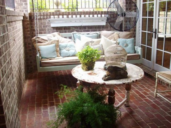 Shabby chic porch swing all comfy with pillows.
