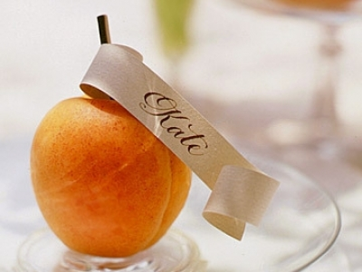 Calligraphy place card holder with lovely fresh peach