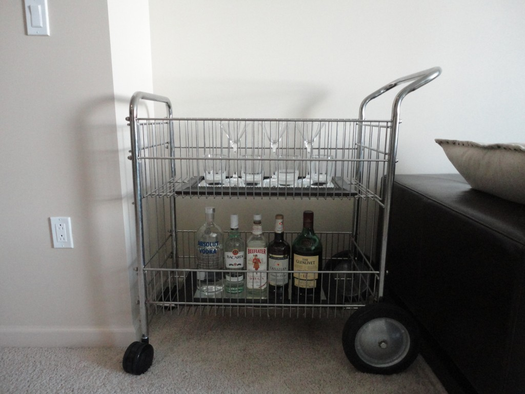 Office mail cart turned into a bar cart in our little apartment