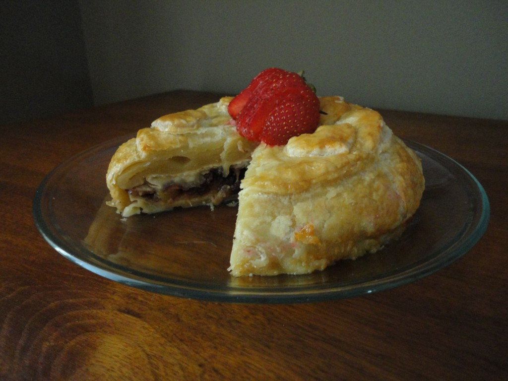 Baked Brie with dried cherries, apricots, toasted almonds and brown sugar in puff pastry