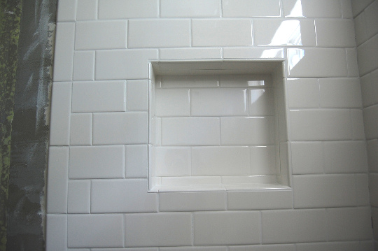 Subway tile in traditional pattern for shower