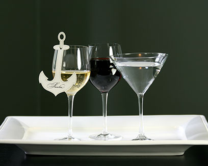 Anchor place cards that hang on your wine glass, perfect for a nautical - themed event.