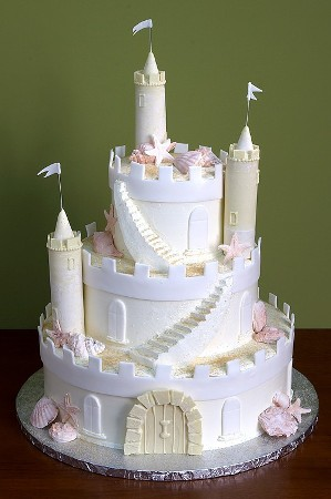 Beach themed castle cake with fondant seashells for wedding cake