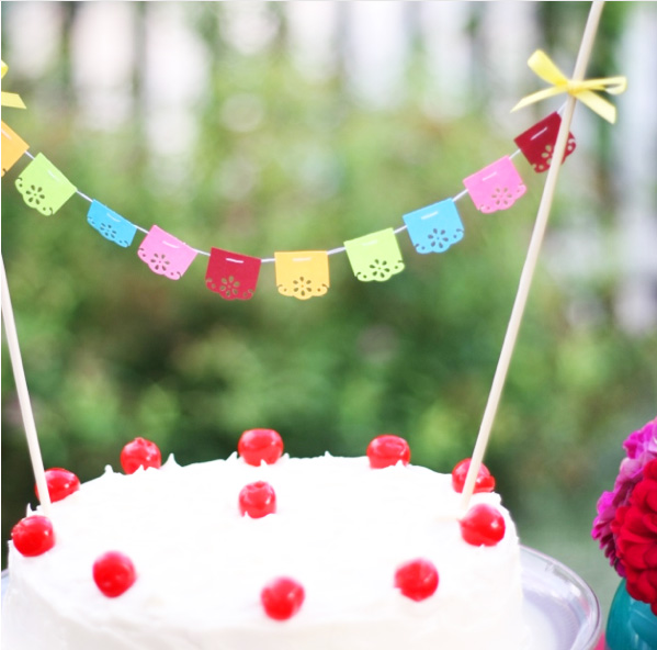 Tiny fiesta bunting, garland or banner on a cake for a party