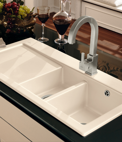 Modern kitchen sink with two bowls and a draining tray