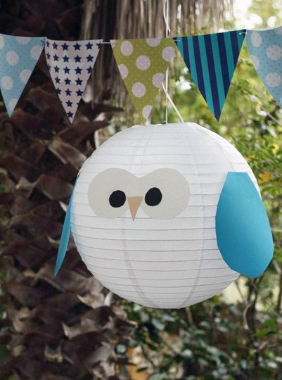 Blue and white owl lantern and banner for an owl-themed party