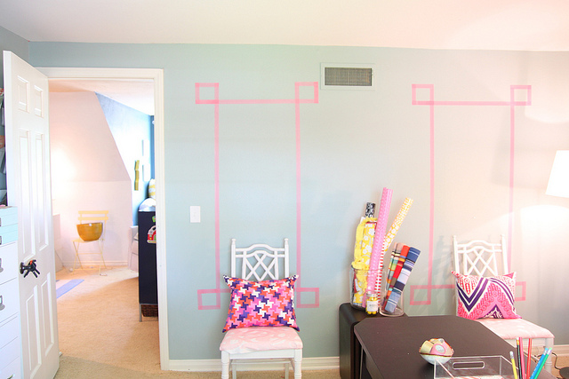 If you live in an apartment and can't paint the walls, get out some washi tape and create some interest on those blank walls!