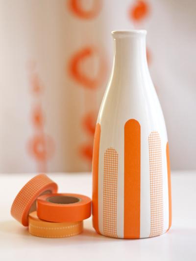 Beautiful washi tape decorated vase or bottle with shades of orane and white