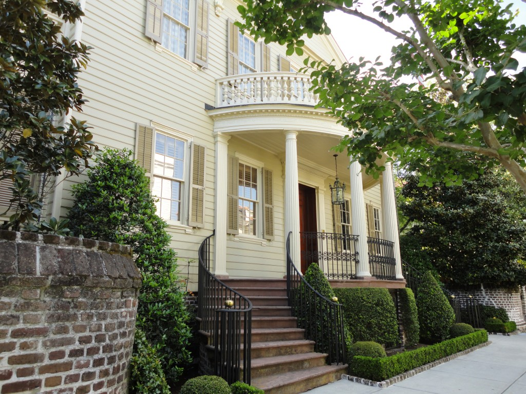 Charleston historic home with a curbed double entrance