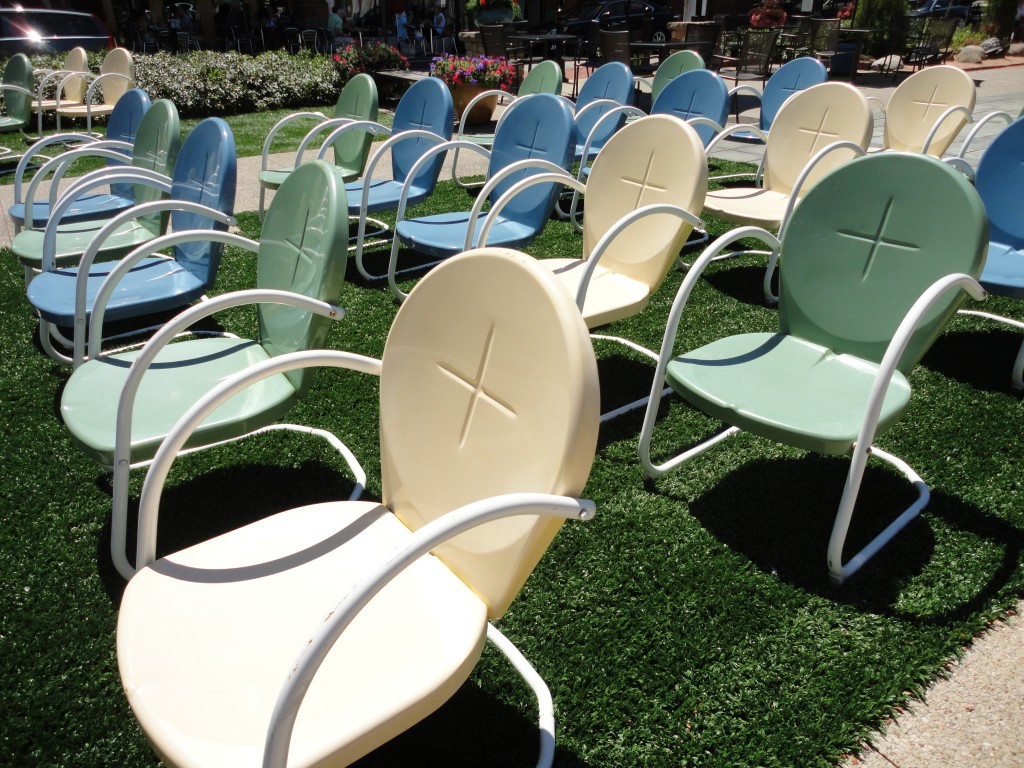 Vintage retro patio chairs on a grassy lawn