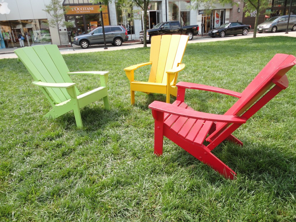 Painted Adirondack chairs in the park