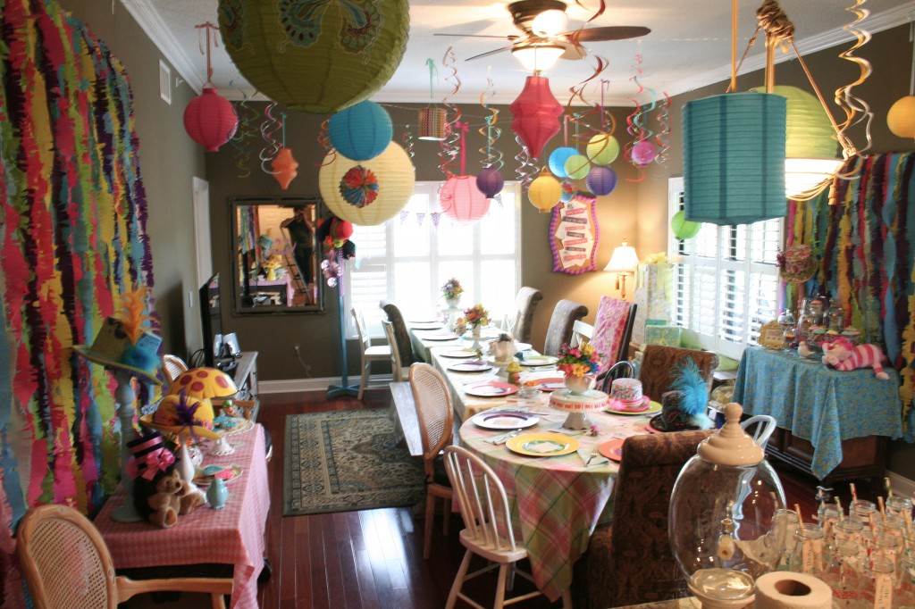 alice in wonderland baby shower with paper lanterns hanging above the