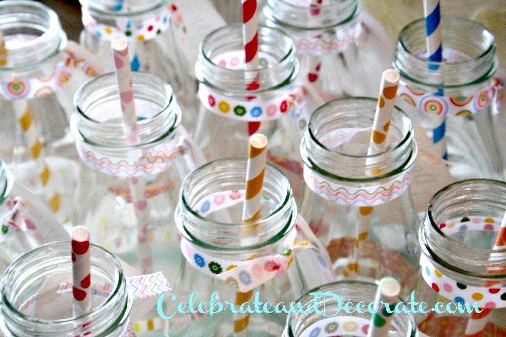 Bottles decorated with washi tape and polka dot straws.