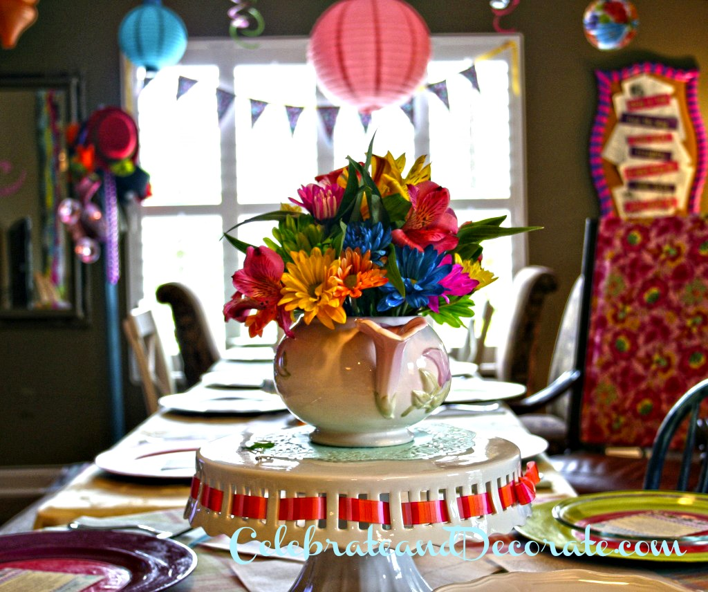 Teapots filled with bright colored flowers decorated the tables.