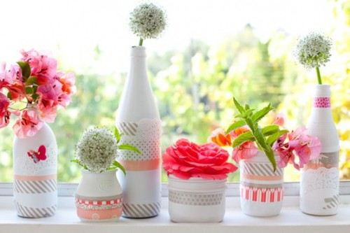 Washi tape vases for a creative centerpiece down a party table
