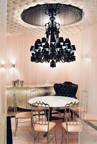Glamourous Dining room in pale pink and black with black chandelier