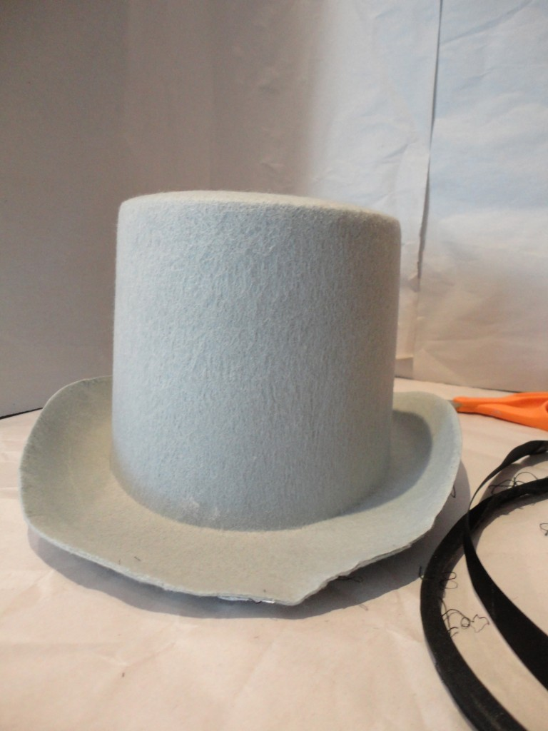 Gray costume top hat with all trim removed