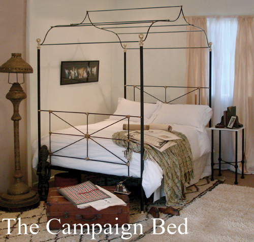 Metal canopy bed which is also a campaign bed, true to the design of the original