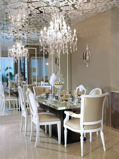 Glamourous dining room with wallpapered ceiling and crystal chandelier