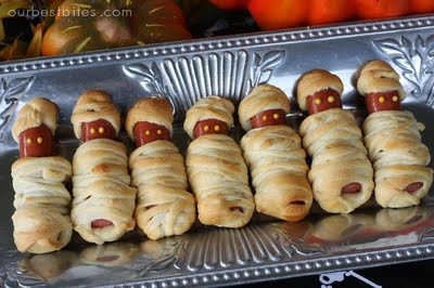Hot dogs baked in crescent rolls to look like little mummies for a Halloween Party
