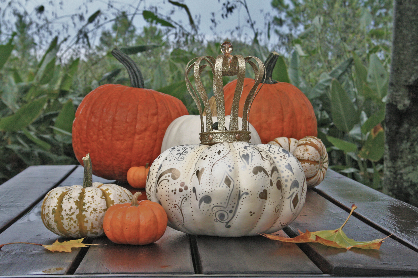 A Royal Pumpkin among the common pumpkins hand decorated for Halloween