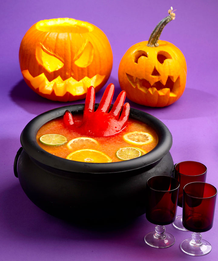 Spooky Halloween punch with floating hand made of ice