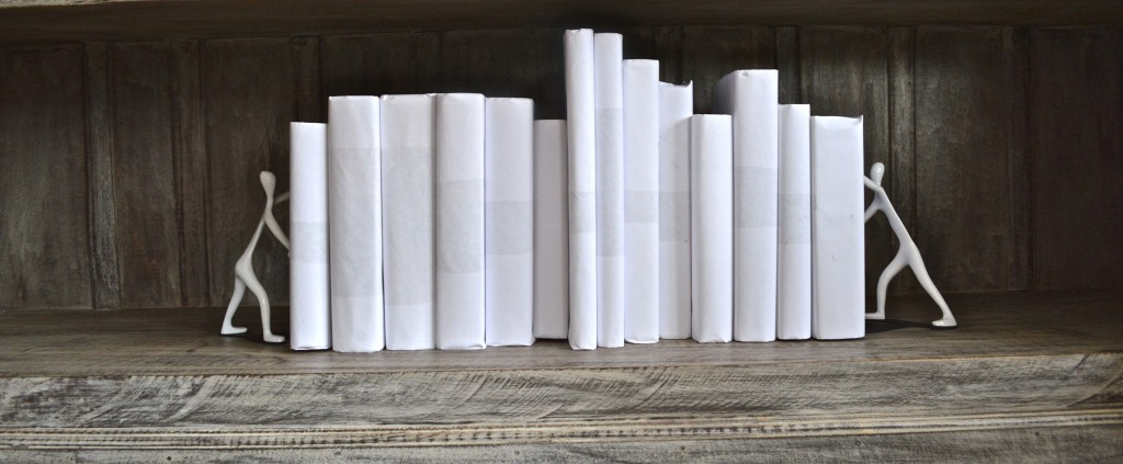 Books covered in white paper.