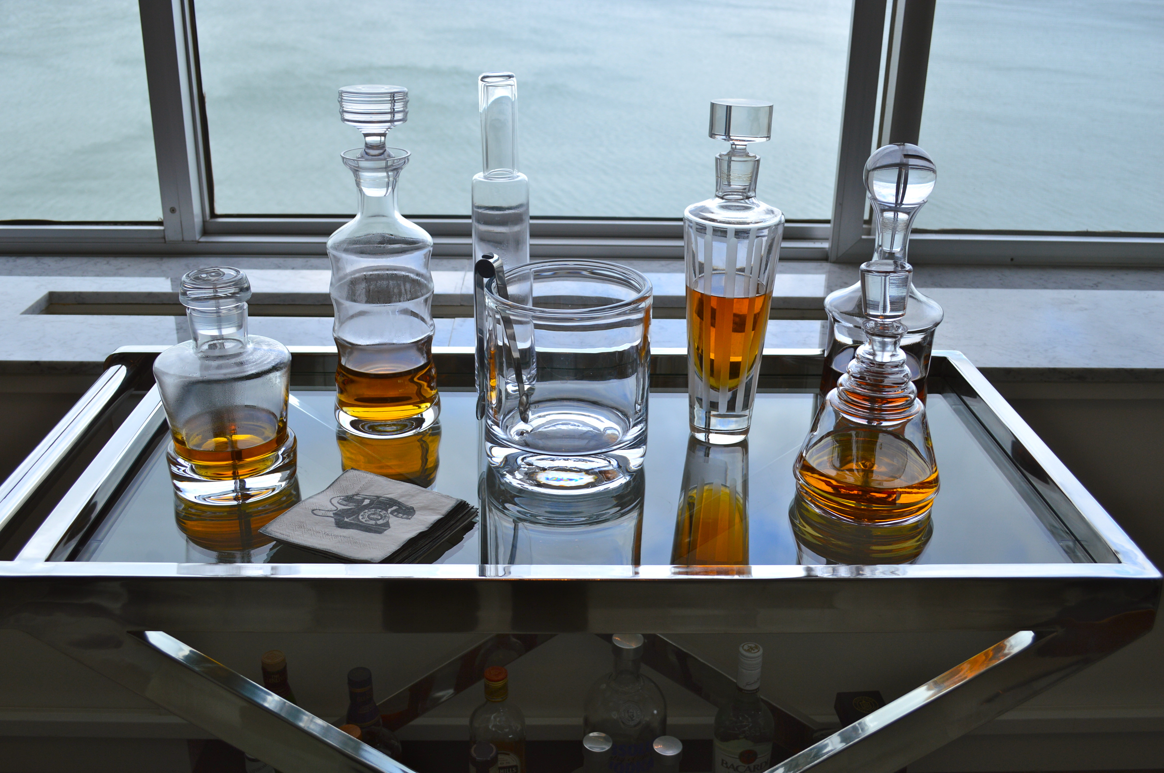Scotch In Decanters On A Bar Cart.
