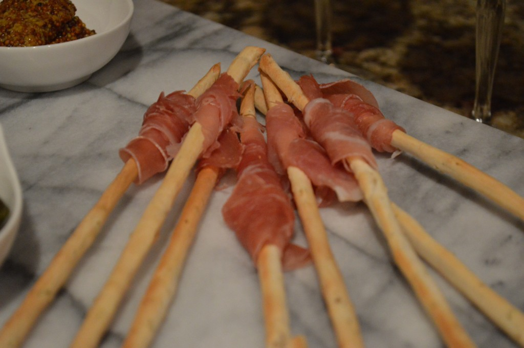 Prosciutto wrapped around fine breadsticks.