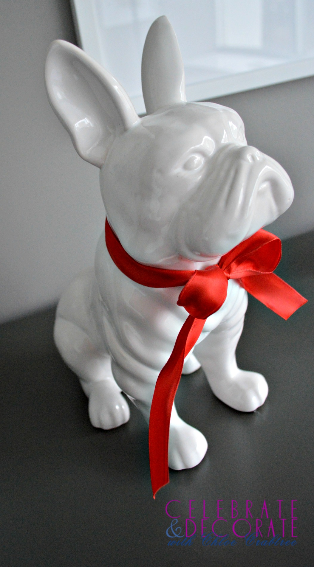French bulldog with red bow