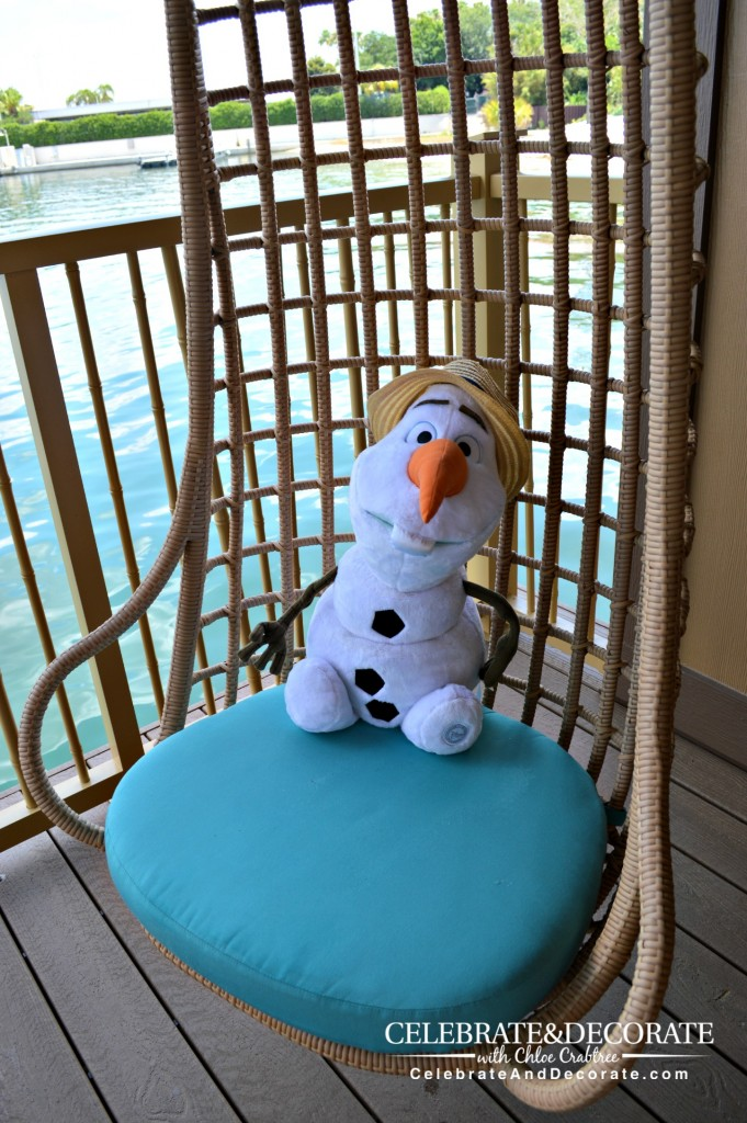 Olaf-enjoys-a-swinging-chair-at-Disney's-Polynesian-Resort