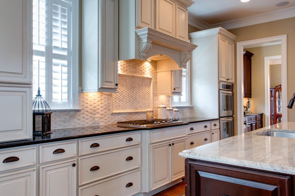 White kitchen with basketweave tile backsplash