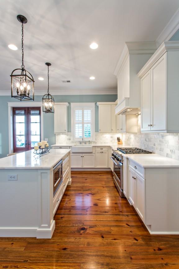 White kitchen with marble subway tile backsplash
