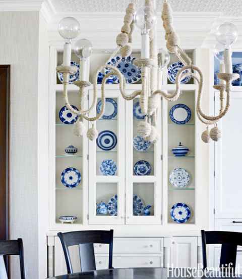 Blue and white dishes in a white hutch