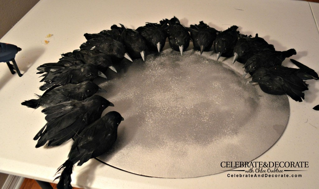 Crows being glued onto wreath form