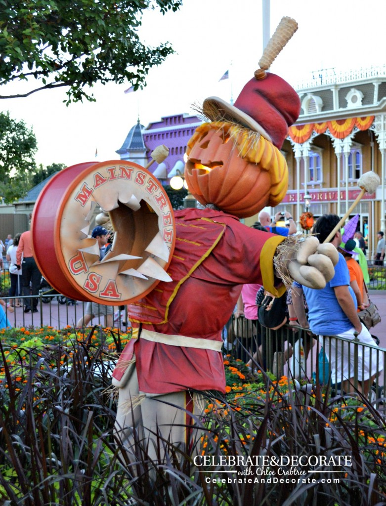 A Band Member Scarecrow greets guests in Town Square