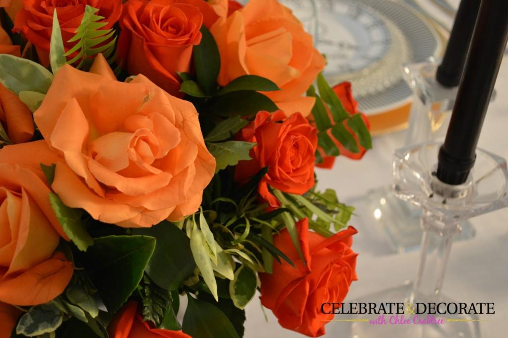 Orange Roses in an elegant centerpiece