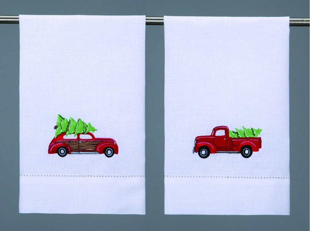 Guest towels for Christmas with a red pick up truck and a woody with Christmas trees