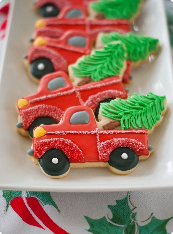 Red truck christmas cookies with a tree in the back